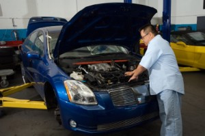 Auto Mechanic checking under the hood